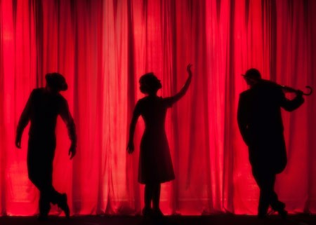 3 people performing in a play
