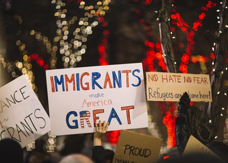 Immigrants make America great protest sign